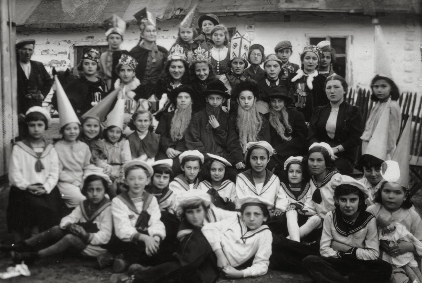 "<p>A Purim celebration in Poland, 1939, just a few years after Manger's <em>Megile</em> was published. Motl Didner of the Folksbiene Theatre specifically <a href=""https://www.yiddishbookcenter.org/language-literature-culture/yiddish-literature/focus-itzik-manger"">identifies</a> Manger's book in the context of and as a commentary on European antisemitism preceding World War <span class=""caps"">II</span>. Image via <span class=""caps"">USHMM</span>.</p>"