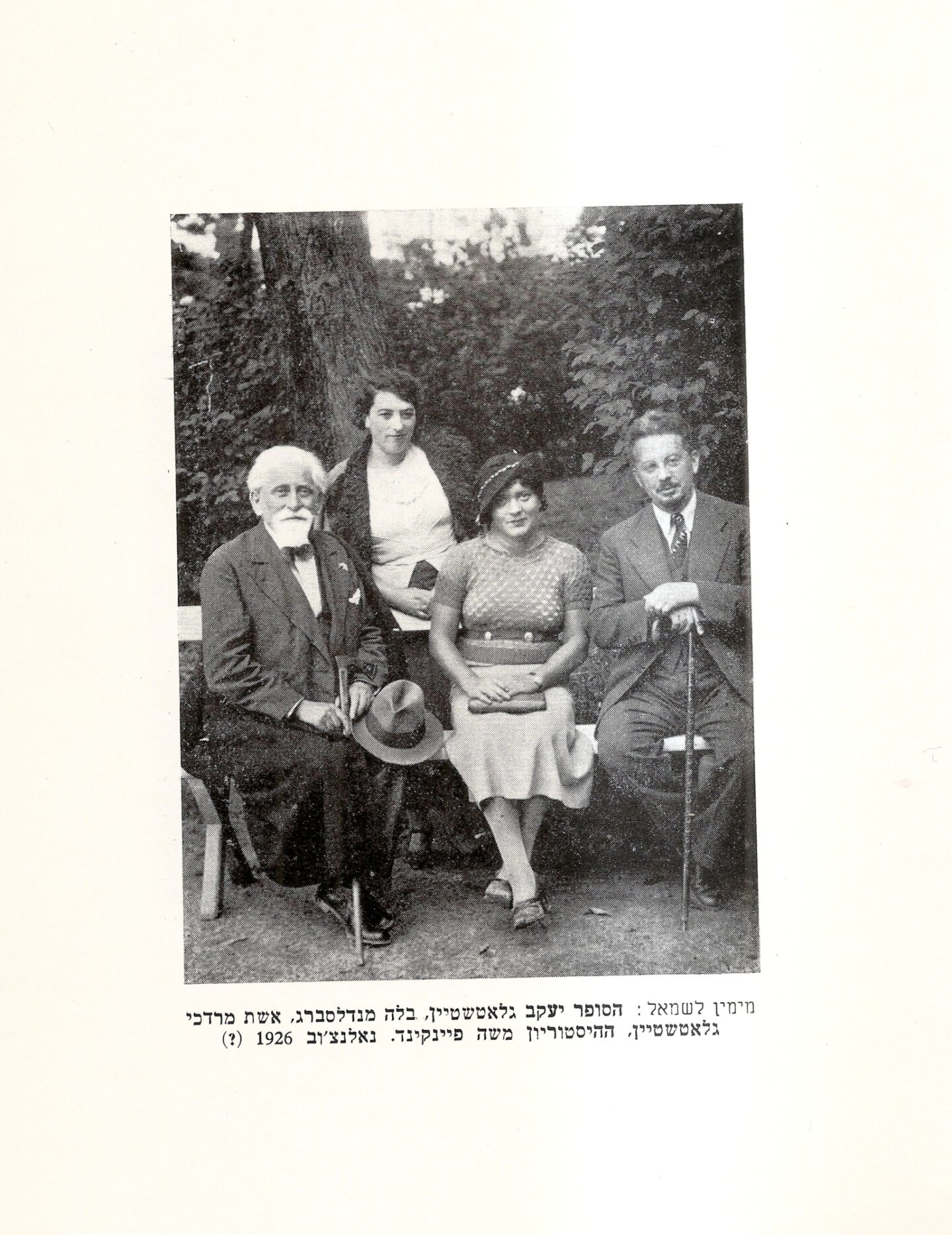 "<p>From right to left: Jacob Glat­stein, Bel­la Man­dels­berg, Glat­stein's sis­ter-in-law, and Moshe Feinkind, in Nałęczów, from Bel­la Man­dels­berg-Schild­kraut's <em>Mekharim le-toldot Yehude Lublin</em> (Cir­cle of Friends of the Late Bel­la Mandelsberg-Schildkraut:Tel-Aviv, <span class=""numbers"">1965</span>). Cour­tesy Moni­ka Adamcyk-Garbowska.</p>"