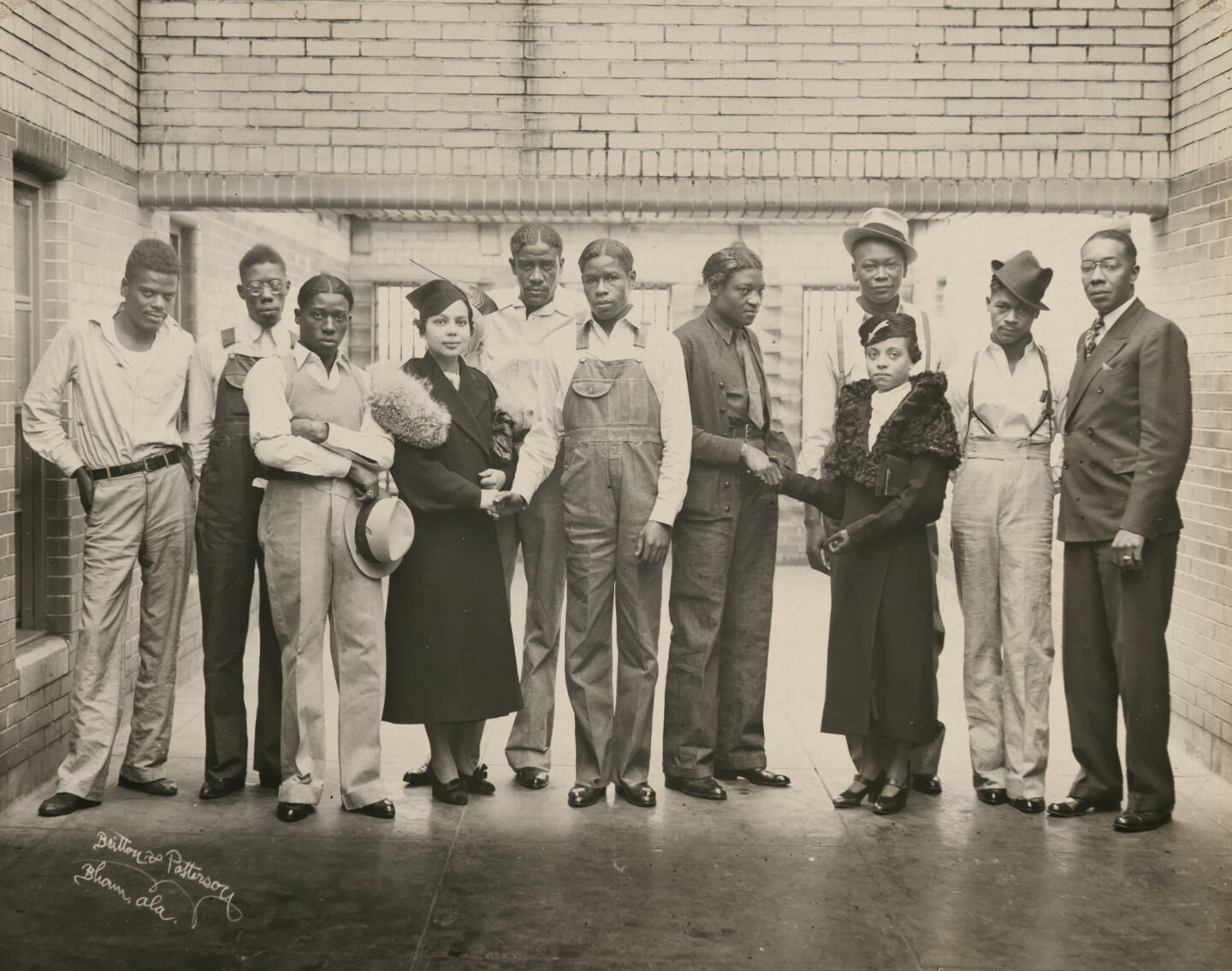 """<p>Photograph of eight of the nine Scottsboro boys together with three <span class=""""caps"""">NAACP</span> representatives, <span class=""""numbers"""">1936</span>, in the prison where they were being held. Image via the National Portrait&nbsp;Gallery.</p>"""
