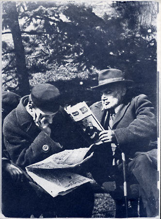"<p>Jewish men sit on a bench in Krasinski Park in Warsaw, reading the special Passover editions of Yiddish newspapers. Photo by Menakhem Kipnes. (Warsaw, 1930's)  via <span class=""caps"">YIVO</span></p>"