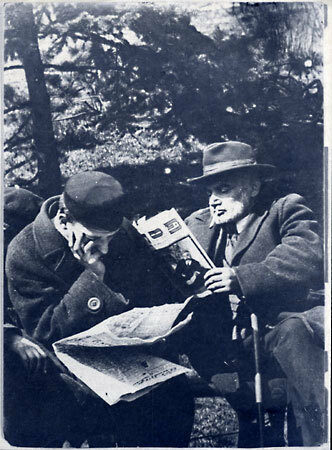 """<p>Jewish men sit on a&nbsp;bench in Krasinski Park in Warsaw, reading the special Passover editions of Yiddish newspapers. Photo by Menakhem Kipnes. (Warsaw, <span class=""""numbers"""">1930</span>'s) via&nbsp;<span class=""""caps"""">YIVO</span></p>"""