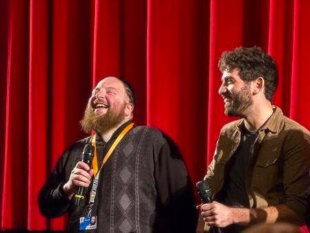 <p>Menashe Lustig (left) and Joshua Z Weinstein (right) during the Q&A session after the first public screening of <i>Menashe</i> at the 2017 Berlin International Film Festival. Courtesy of Yoni Brook and Joshua Z Weinstein.</p>