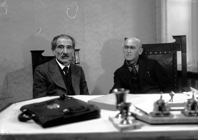 "<p>Moishe Litvakov, editor-in-chief of the Soviet Yiddish newspaper <em>Der emes </em>(The Truth) looks askance at Yiddish writer Avrom Reisen (left). Soviet Yiddish Newspaper <em>Der Emes</em>, 1929, <span class=""caps"">CC</span> <span class=""caps"">BY</span>-<span class=""caps"">SA</span> 4.0, <a href=""https://commons.wikimedia.org/w/index.php?curid=39156861"">https://commons.wikimedia.org/w/index.php?curid=39…</a></p>"