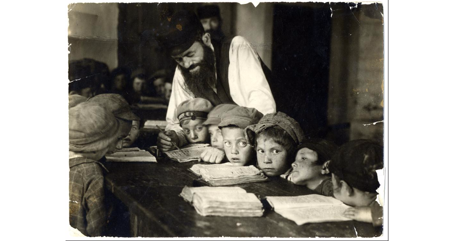 "<p>Teacher and students in a cheder, Lublin, Poland. Alter Kacyzne, 1920s.&nbsp;(<span class=""caps"">YIVO</span>)</p>"