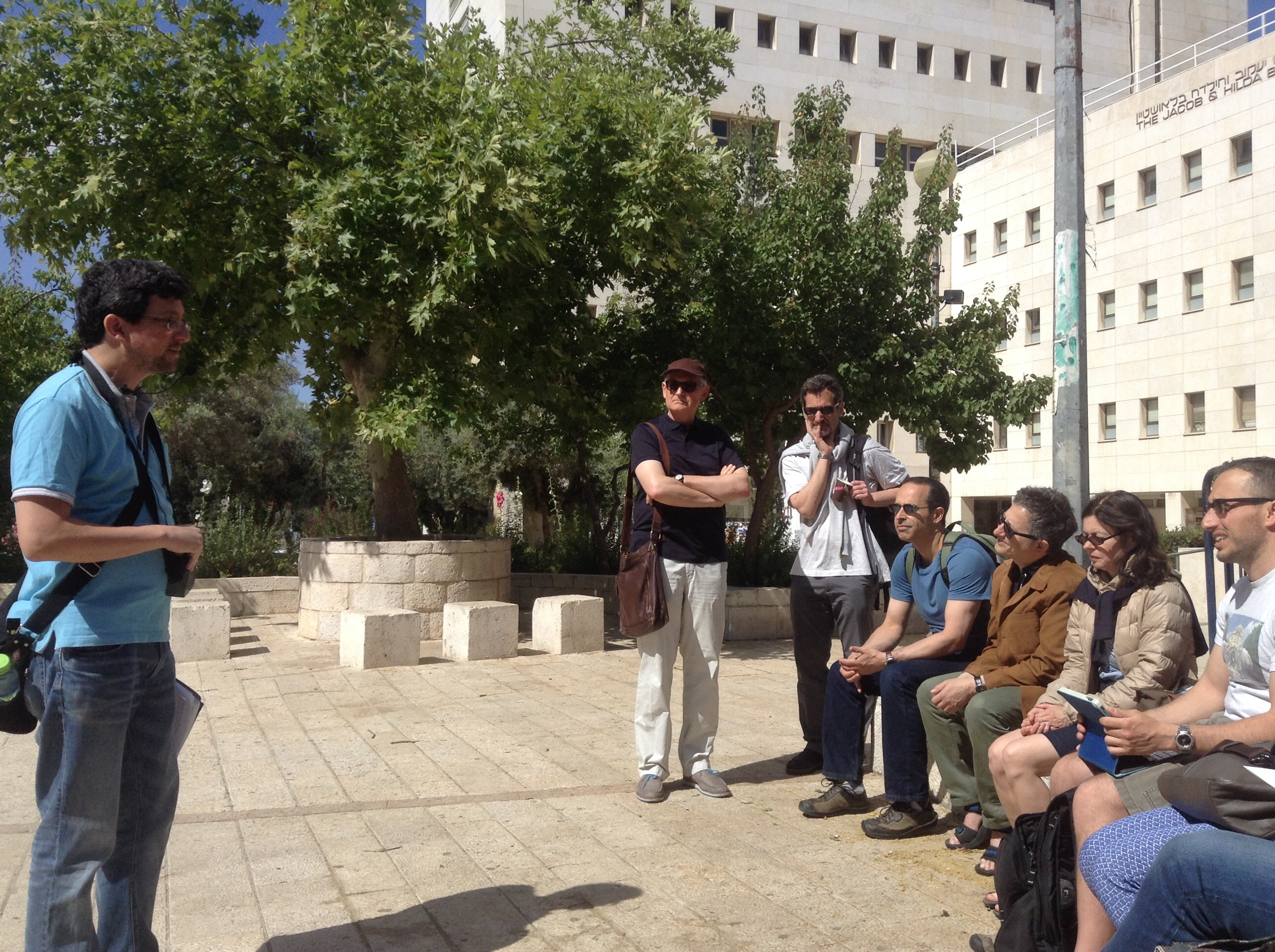 <p>Yaad Biran and conference participants on a Yiddish-language tour of Jerusalem. Photo courtesy Sonia Gollance</p>