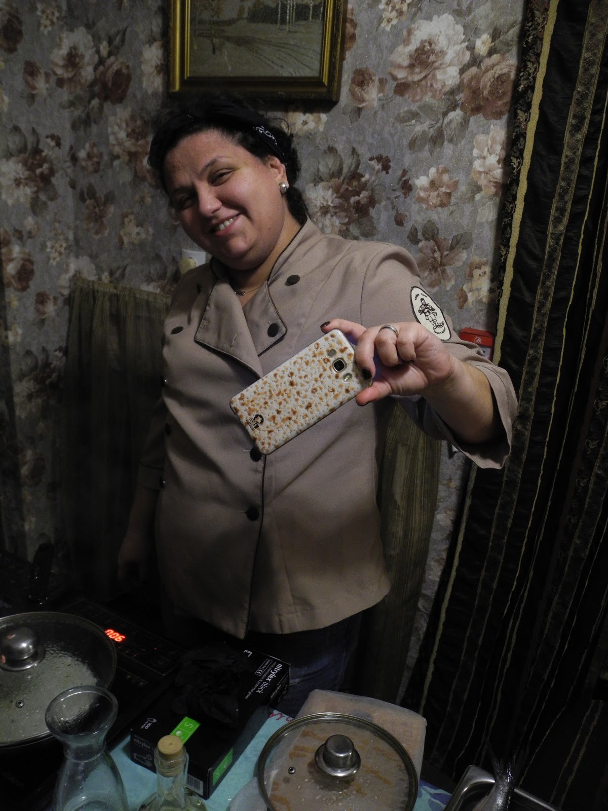 <p>Chef Lola Landa, pictured here with thematically consistent matzo phone case.</p>