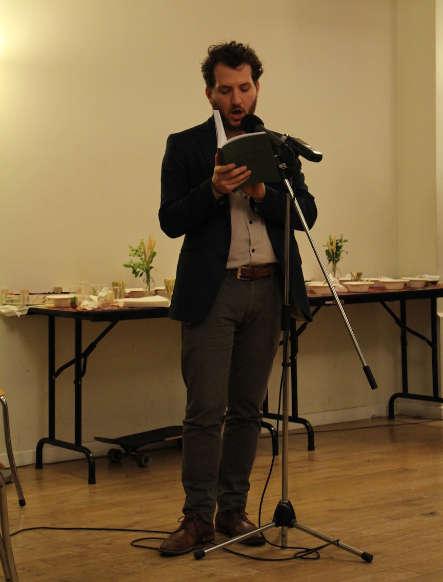 "<p>Tal Hev­er-Chy­bows­ki read­ing from <em>Mikan Ve'ey­lakh</em> at the jour­nal's launch par­ty at the Medem Library in Paris,&nbsp;<span class=""numbers"">2016</span>.&nbsp;</p>"