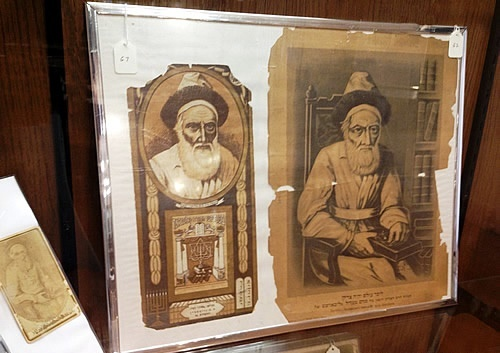<p>Portraits of the Tsemakh Tsedek, R. Menachem Mendel Schneersohn of Lubavitch on display at the Central Chabad Library in New York (photo courtesy of&nbsp;Chabad.org)</p>