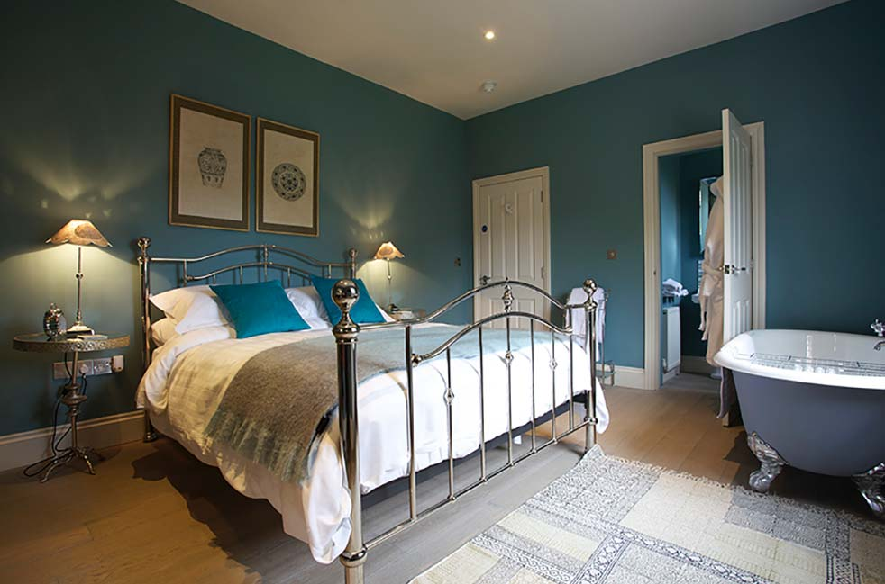 Folly - A delightful room at the Packhorse Inn, Suffolk, which overlooks the terraced garden.