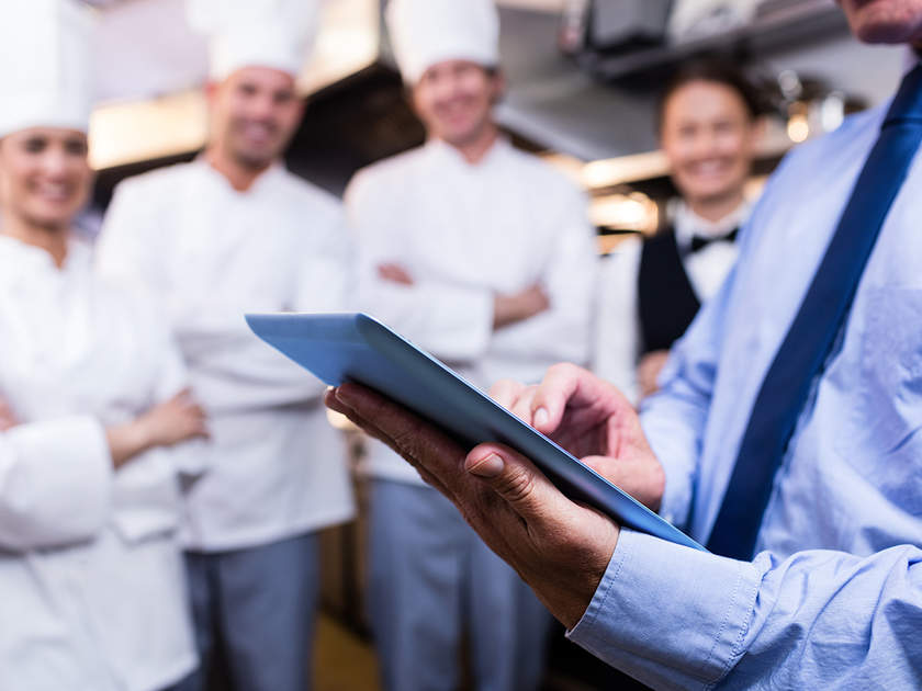 Restaurant manager conducting a checklist with employees
