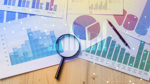 Magnifying Glass and Data Charts