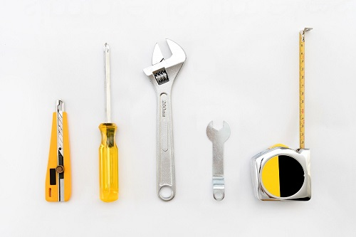 Tools Laid on a White Table