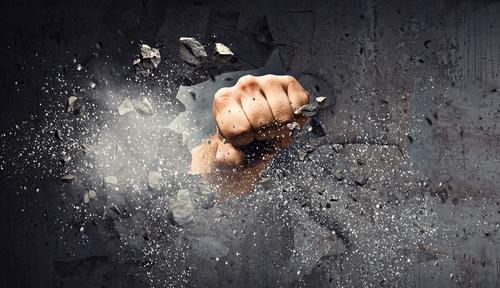 Fist Breaking Through a Wall