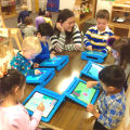 Ms. Nikki teaches the children with games on the iPads.