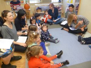 Pre-K students participating in a United Nations Day sing-along inside their classroom.