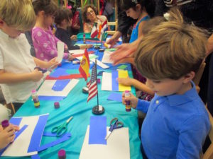 Junior Kindergarten classroom working on a United Nations Day project at their celebration.