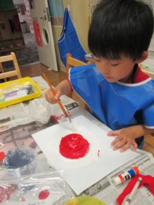 Junior K students at 86th Street created paintings of flags that represent their families.