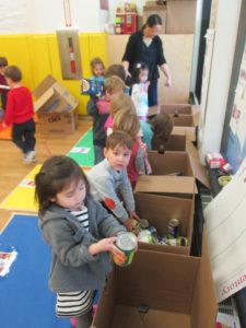 Students sorting food donations for the New York Common Pantry.