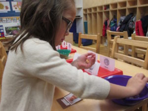 At the 86th Street location, children sorted dimes, nickels, quarters, and pennies for UNICEF.