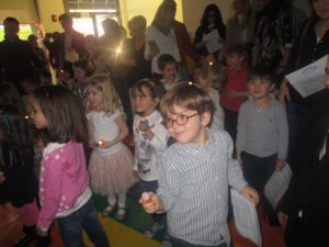 Last year's Winter Solstice Sing-Along at our 86th Street location was a great success! Here, children use flashlights as props during one of the songs.