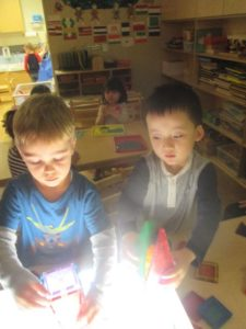 Light table exploration using magnet tiles was a popular activity.
