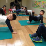 "Children created ""bridges"" using their bodies during Movement class."