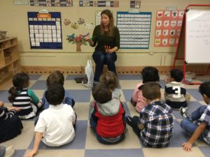 45th Street teacher Ms. Robyn teaches her class about tools to use in the school's rooftop garden.