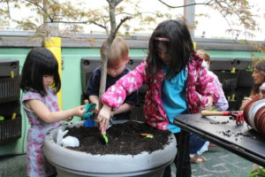 Children working on the 45th Street rooftop garden.