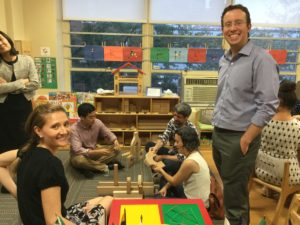 """Parents at our 76th Street location """"work"""" in the block center, where skills such as balance, shape recognition, and working collaboratively take place!"""