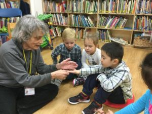 Ms. Mary works with students during her science class at The International Preschools.