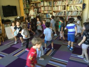 Ms. Peggy leads a creative movement class at The International Preschools.