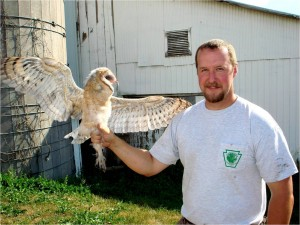 Banded Barn Owl held by Kevin Wenner of NE PGC, by Wayne Laubscher