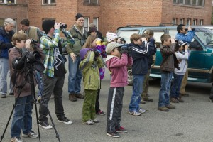 Participants practice using binoculars during Binocular Boot Camp. Photo by Christine Hansen.