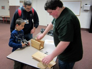 Stephen Bischoff, OYBC member and conference speaker, shows a fellow young birder how to construct a nestbox. Photo by Kelly McKinne.