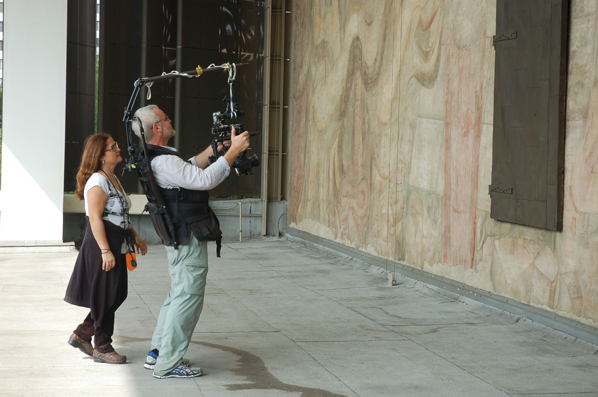 Lorena and Miguel with steadicam in front of Siqueiros mural