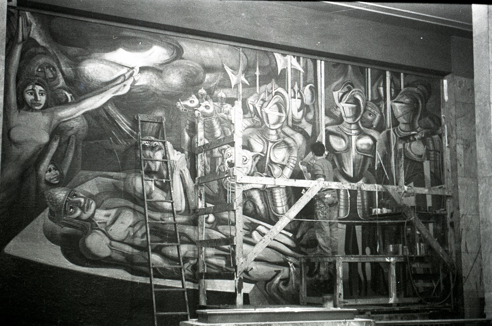 Artist David Siqueiros working on a giant wall mural, black and white photo