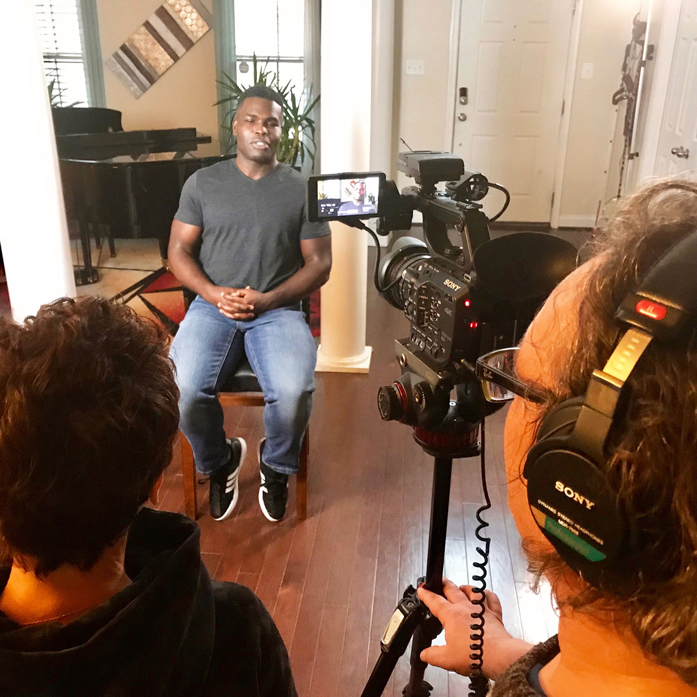 African American young man Mario being interviewed by Patty Zagarella and crew, for Blind Love