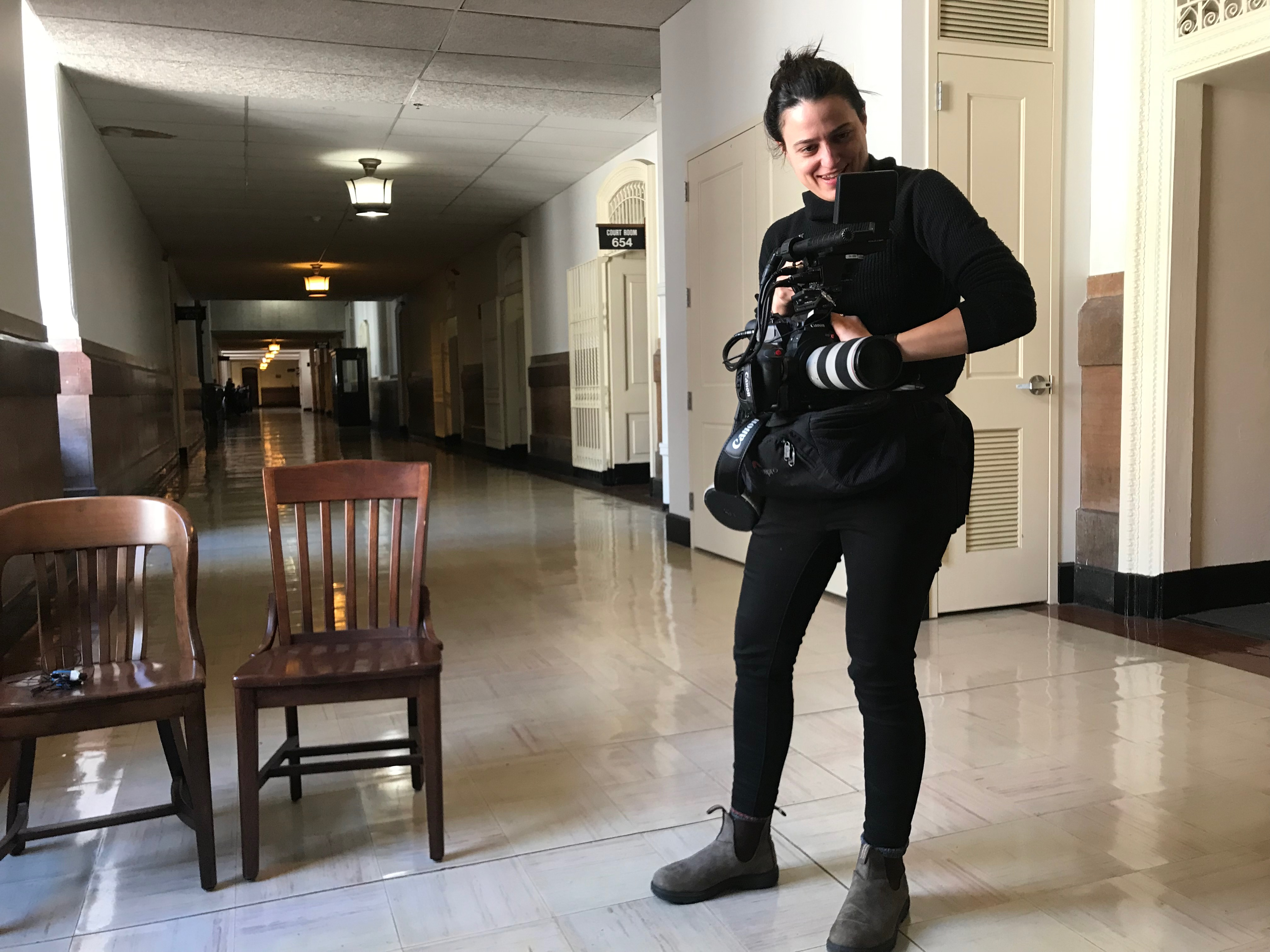 Nicole Salazar with camera in halls of D.A. office