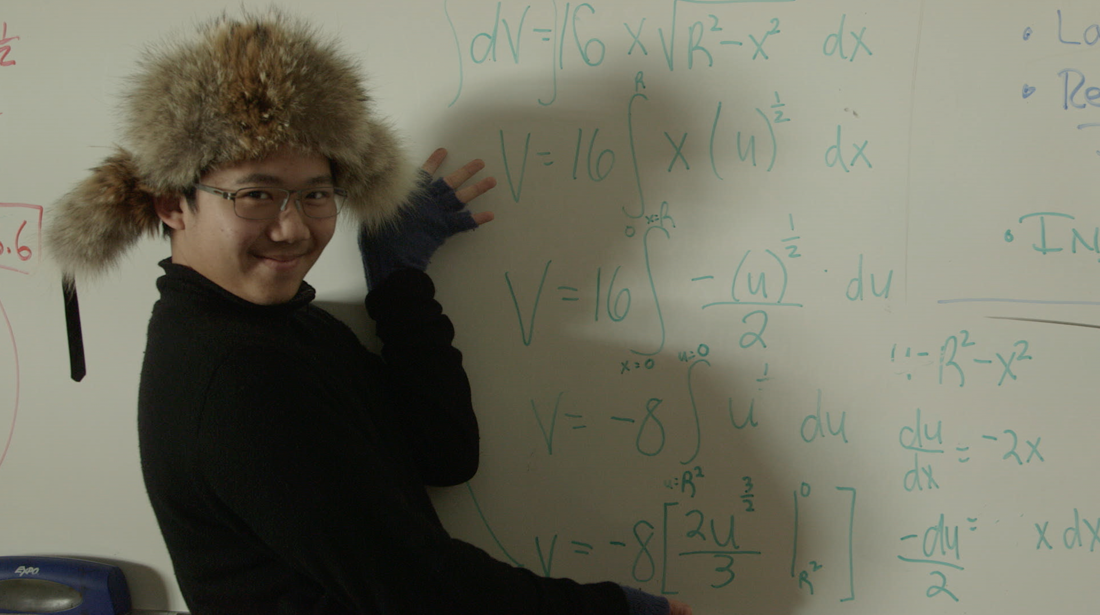 a student clowns around in front of math class white board at Lowell High School, in Try Harder