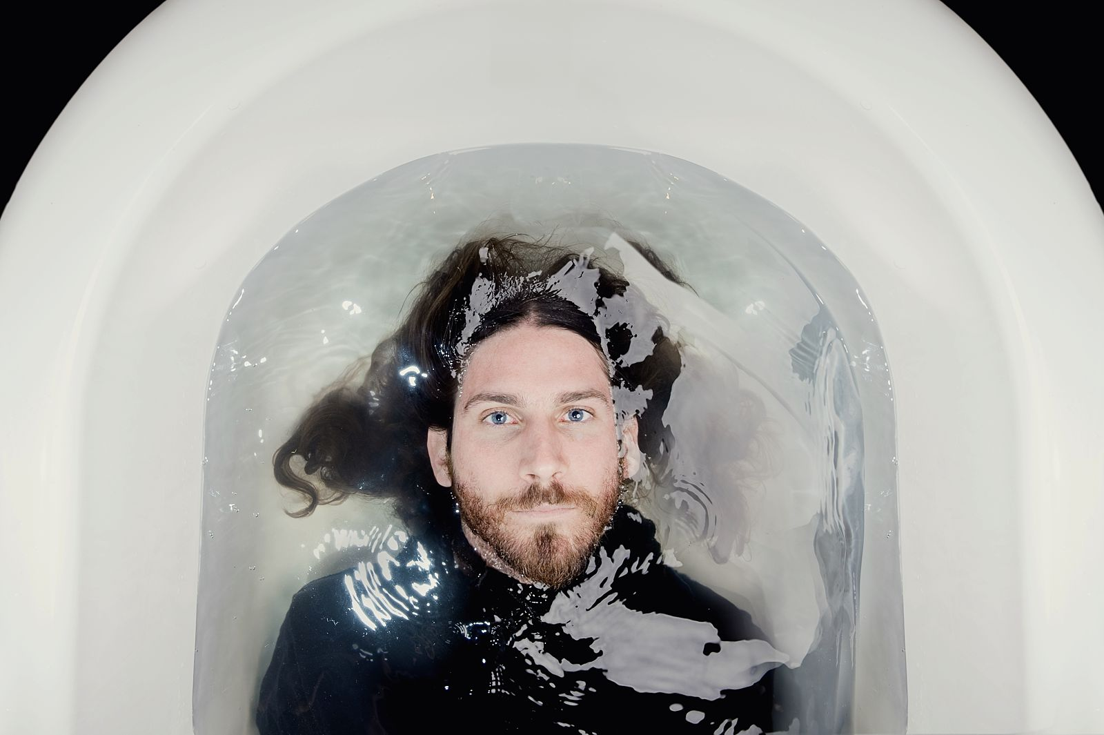 Creative portrait of Guy Buttery in the bath
