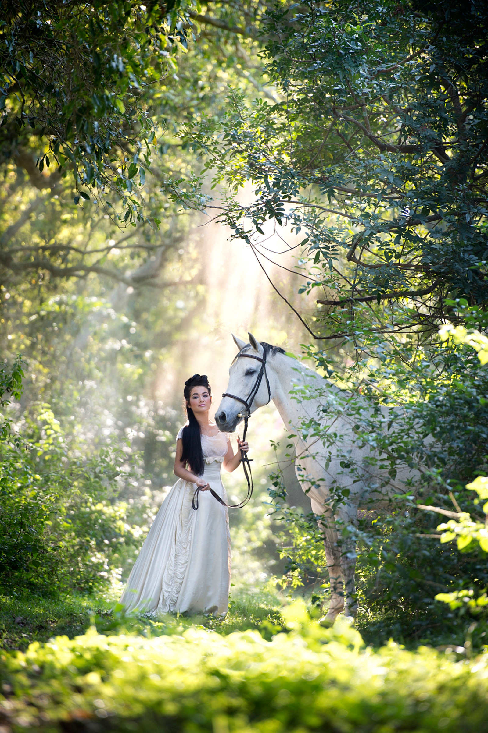 Girl in white dress with horse in amazing light