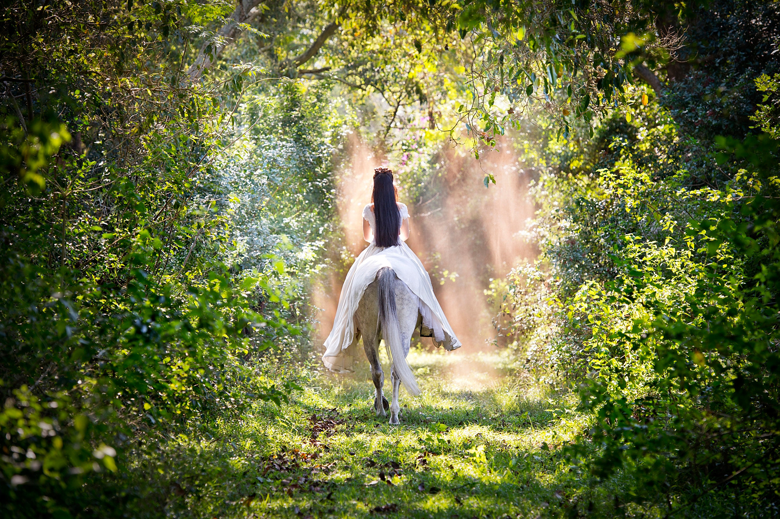 Girl riding away on a horse