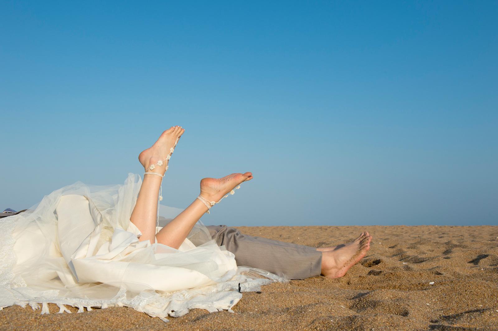 bride and groom feet on a beach