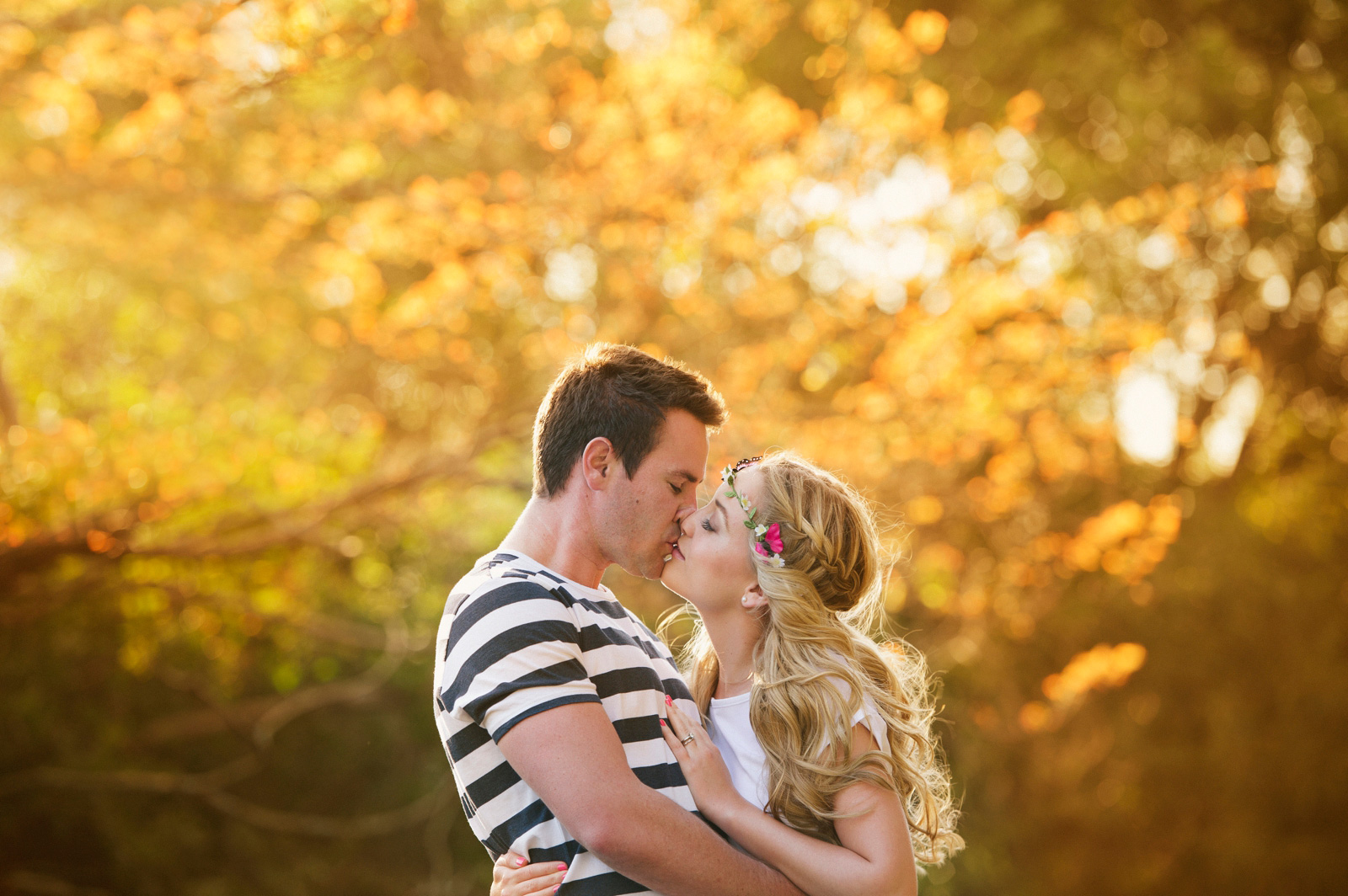 Couple kissing in golden light