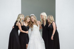 Bride with bridesmaids in black Bride getting into dress Wedding at the Oyster Box Hotel Durban South Africa