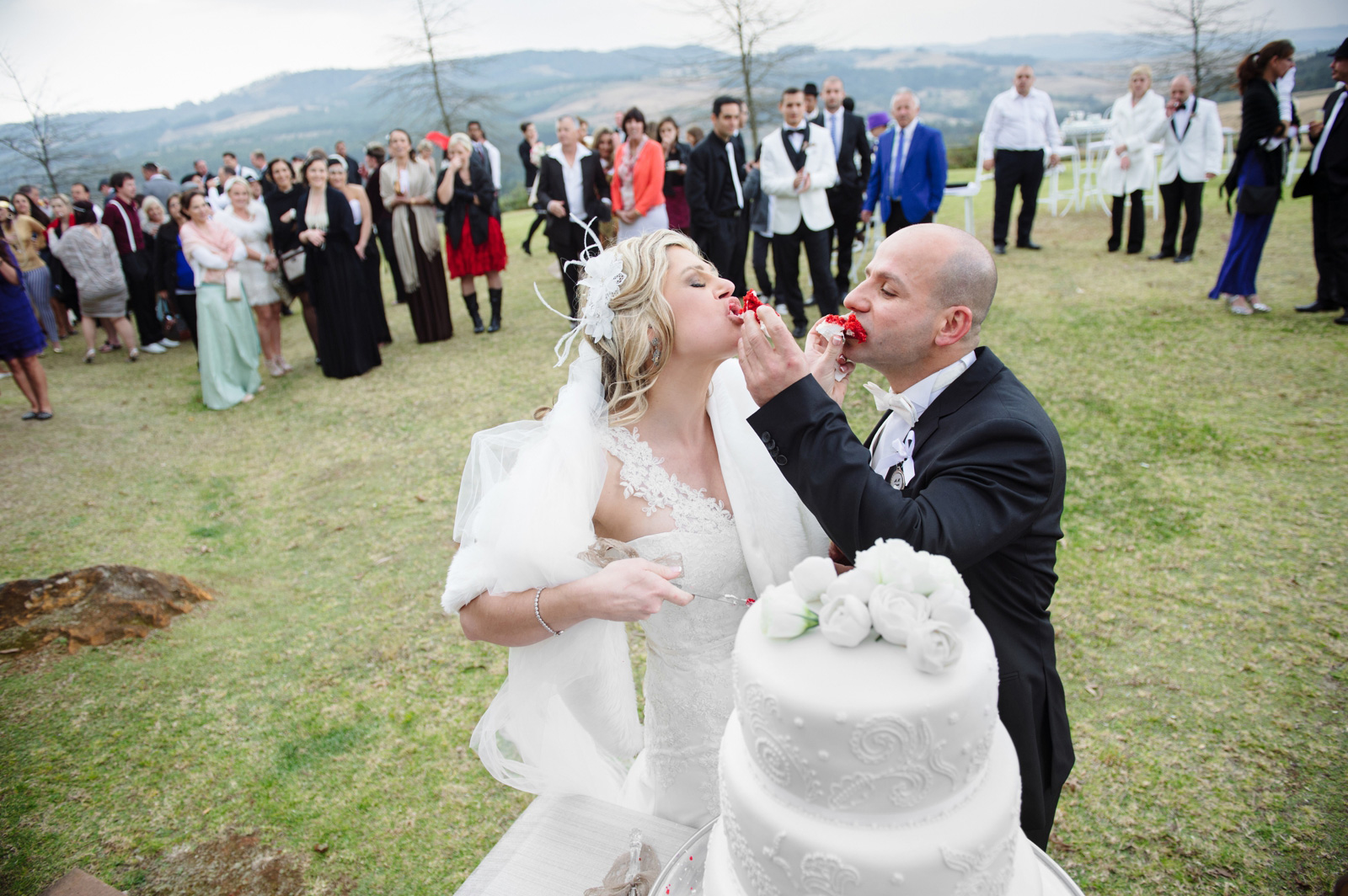 Bride and groom eating cake at Woodridge