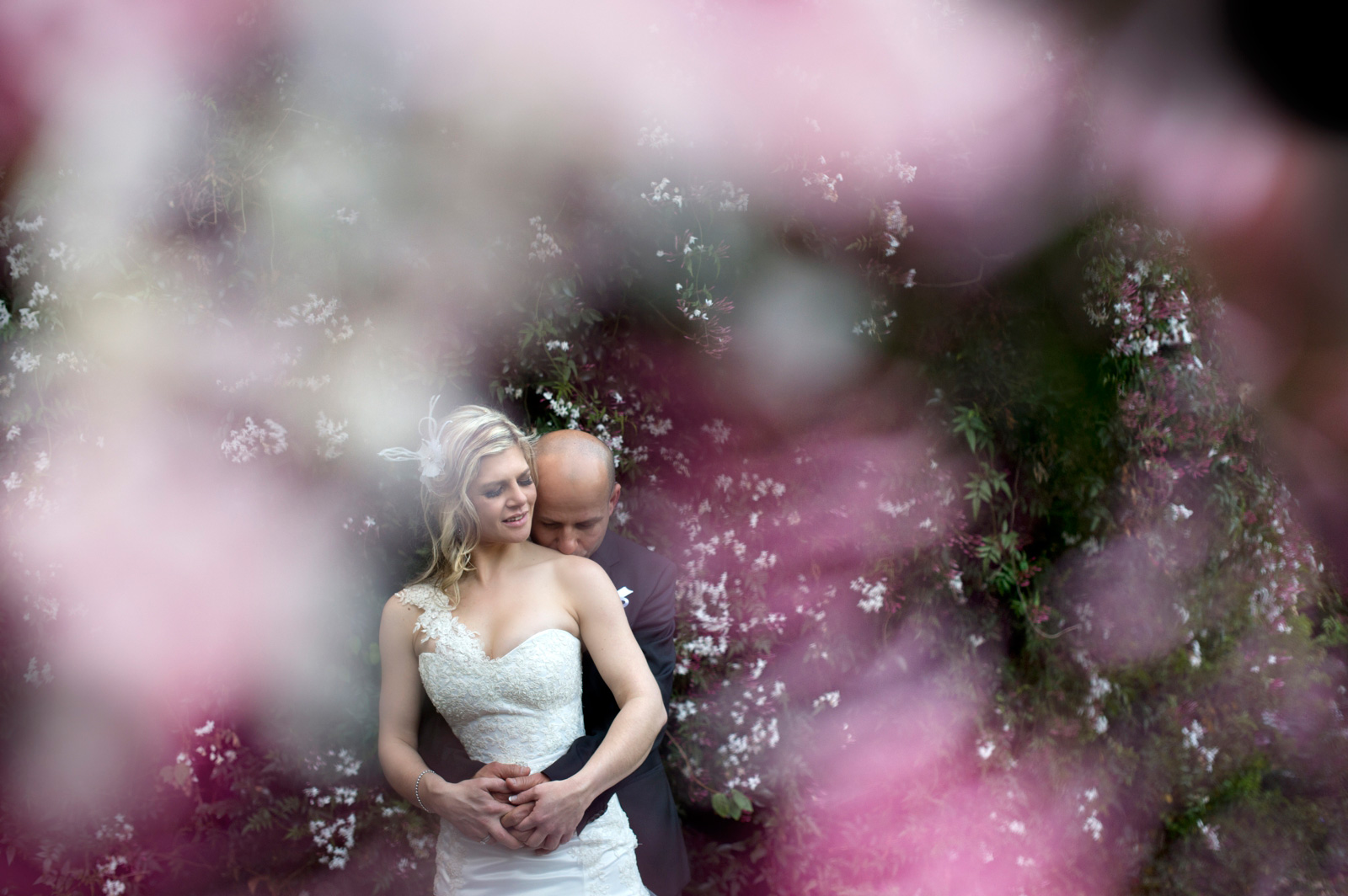 Bride and Groom with pink flowers