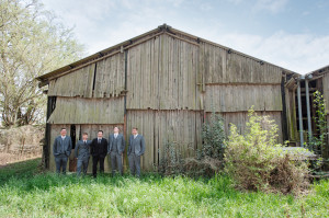 Groom with groomsmen on barn door