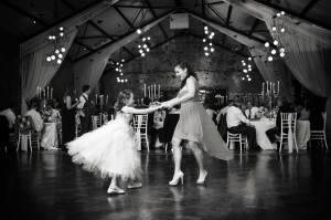 child dancing at a wedding