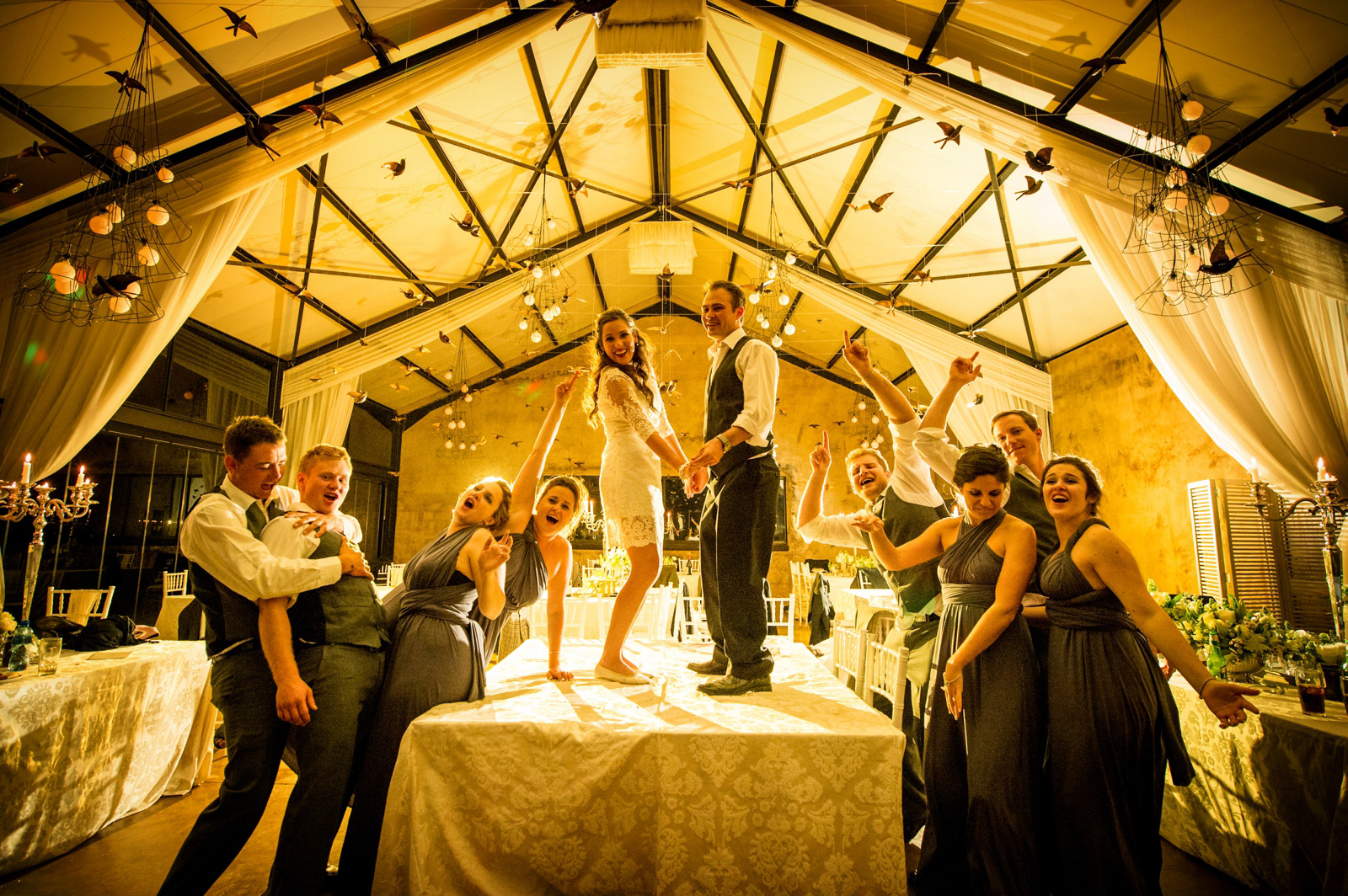 bride and groom dance on a table